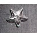 Černá plovoucí svíčka ve tvaru hvězdy